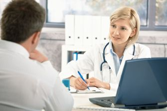 A stock photo of a patient consulting doctor.